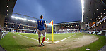 Lewis MacLeod prepares to take a corner kick in front of 46,500 spectators at Ibrox Stadium..