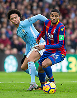 Jairo Riedewald of Crystal Palace turns Leroy Sane of Manchester City during the Premier League match between Crystal Palace and Manchester City at Selhurst Park, London, England on 31 December 2017. Photo by Andy Rowland.