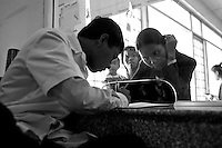 A young doctor filling the registation form for a patient in the reception room. Approximately 54% of Cambodian are physicians employed in Phnom Penh. Only 9.3% of the country population live in the city.
