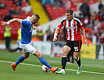 Paul Coutts of Sheffield Utd plays the ball past Marcus Maddison of Peterborough Utd  during the League One match at Bramall Lane Stadium, Sheffield. Picture date: September 17th, 2016. Pic Simon Bellis/Sportimage