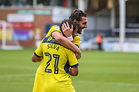 Agon Mehmeti of Oxford United celebrates at the final whistle with Ricardo Ferreira da Silva of Oxford United during the Sky Bet League 1 match between Peterborough and Oxford United at the ABAX Stadium, London Road, Peterborough, England on 30 September 2017. Photo by David Horn.