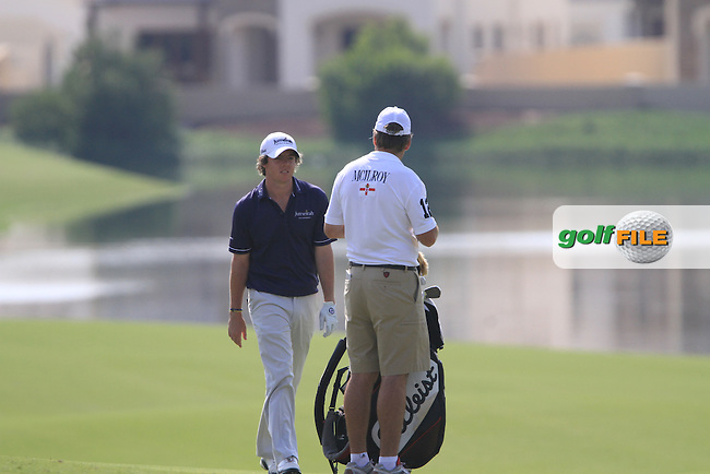 Rory McIlroy and his caddy check his line before playing his 2nd shot on the 14th hole during Day 3 of the Dubai World Championship, Earth Course, Jumeirah Golf Estates, Dubai, 27th November 2010..(Picture Eoin Clarke/www.golffile.ie)