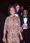 Mary Tyler Moore with Dr. Robert Levine attends the Broadway Salute to Liz Smith in Schubert Alley on August 1, 1983 in New York City.