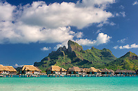 Bungalows over water and Mt. Otemanu. Bora Bora. French Polynesia