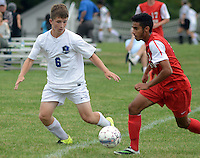 Central Bucks South's Colin Green #6 dribbles the soccer ball past Souderton's Nick Marculo in the first half at Central Bucks South High School Monday September 21, 2015 in Warrington, Pennsylvania.   (Photo By William Thomas Cain)