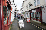 Shoppers and specialist small shops in Mill Street, Bideford, Devon, England