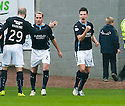 Dundee's Thomas Konrad (right) celebrates after he scores their first goal.