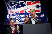 United States President Barack Obama receives applause from Democratic National Committee chairman Tim Kaine (L) as he delivers remarks at the Democratic National Committee (DNC) winter meeting on February 6, 2010 in Washington, DC. Top party officials and supporters gathered for the annual meeting to map out their agenda for the year. .Credit: Brendan Hoffman - Pool via CNP
