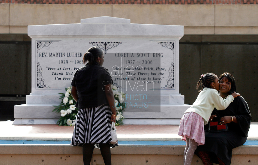 Brianna Brown (left), 12, her sister Chantelle, 9, and their mother, Crystal, visit the tomb of Dr. Martin Luther King Jr. and his wife, Coretta Scott King, at the Martin Luther King Jr. National Historic Site.<br />