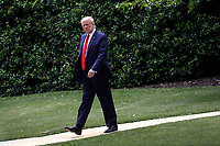United States President Donald J. Trump walks from the Oval Office of the White House in Washington, DC before his departure to Detroit on May 21, 2020. Trump is going to participate in a listening session with African-American leaders and tour Ford Rawsonville Components Plant in Ypsilanti, Michigan. <br /> Credit: Yuri Gripas / Pool via CNP/AdMedia