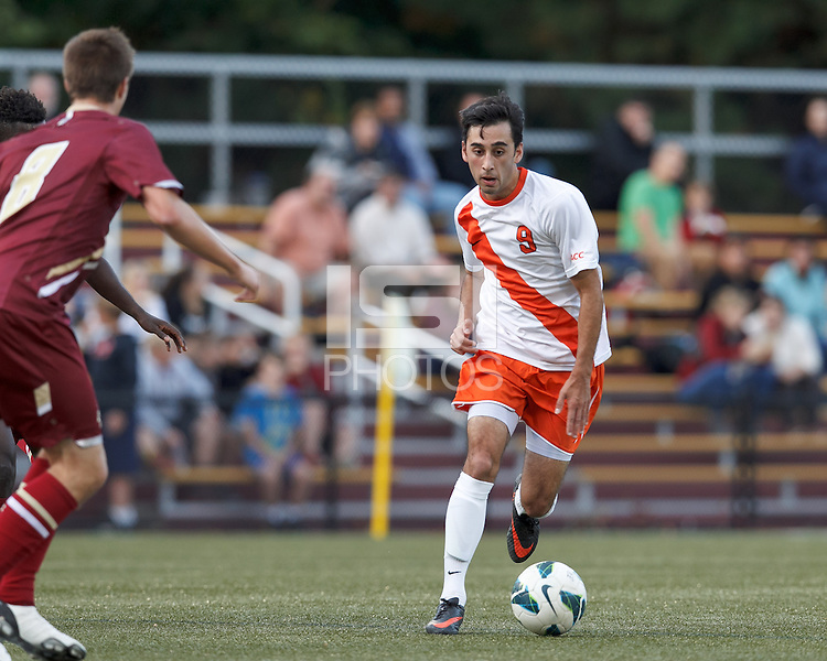 Syracuse University midfielder Stefanos Stamoulacatos (9) drives for the net. Boston College (maroon) defeated Syracuse University (white/orange), 3-2, at Newton Campus Field, on October 8, 2013.
