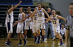 The Reno Huskies clear the bench after defeating the Liberty Patriots 50-39 to clinch the Division I title in the NIAA basketball state tournament at Lawlor Events Center, in Reno, Nev., on Friday, Feb. 28, 2014. (Cathleen Allison/Las Vegas Review-Journal)