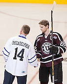 Mat Bodie (Union - 22) shakes hands with Paul Holmgren. - The Union College Dutchmen defeated the University of Minnesota Golden Gophers 7-4 to win the 2014 NCAA D1 men's national championship on Saturday, April 12, 2014, at the Wells Fargo Center in Philadelphia, Pennsylvania.