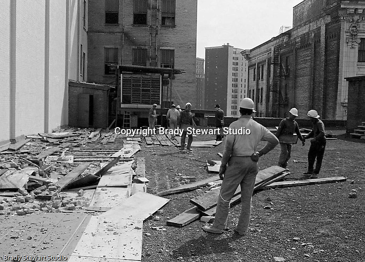 Pittsburgh PA:  View of the building demolition of one of downtown Pittsburgh's grand department stores, Rosenbaums. Construction workers pulling up roof planks.  Located at Penn Avenue and Sixth Street in Pittsburgh, the store closed in 1960 and taken down in 1963 to make way for the Sixth Avenue garage.  The demolition work was completed by D&H Building Wreckers.