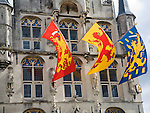 Flags flying on the town hall, Gouda, South Holland, Netherlands,