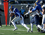 BROOKINGS, SD - DECEMBER 9: Taryn Christion #3 from South Dakota State University scampers past Brian Carter #99 from the University of New Hampshire for a touchdown during their FCS quarterfinal game Saturday afternoon at Dana J. Dykhouse Stadium in Brookings, SD. (Photo by Dave Eggen/Inertia)