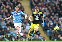 2nd November 2019; Etihad Stadium, Manchester, Lancashire, England; English Premier League Football, Manchester City versus Southampton; Kevin De Bruyne of Manchester City passes the ball while chased by Stuart Armstrong of Southampton - Strictly Editorial Use Only. No use with unauthorized audio, video, data, fixture lists, club/league logos or 'live' services. Online in-match use limited to 120 images, no video emulation. No use in betting, games or single club/league/player publications