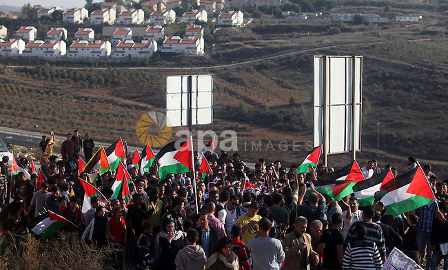 Palestinians carry the body of Rushdi Tamimi, 31, during his funeral procession in the West Bank city of Ramallah November 20, 2012. amimi was wounded during a protest against Israel's operation in Gaza on Saturday, Nov. 17, 2012. Efforts to end a week-old convulsion of Israeli-Palestinian violence drew in the world's top diplomats on Tuesday, with President Barack Obama dispatching his secretary of state to the region on an emergency mission and the U.N. chief appealing from Cairo for an immediate cease-fire. Photo by Issam Rimawi
