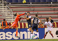BOCA RATON, FL - DECEMBER 15, 2012: Abby Wambach (14) of the USA WNT loses the ball to Wang Fei (12) of China WNT during an international friendly match at FAU Stadium, in Boca Raton, Florida, on Saturday, December 15, 2012. USA won 4-1.