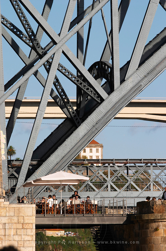 Dom Luis I bridge seen from Cais da Ribeira restaurant terrace porto portugal