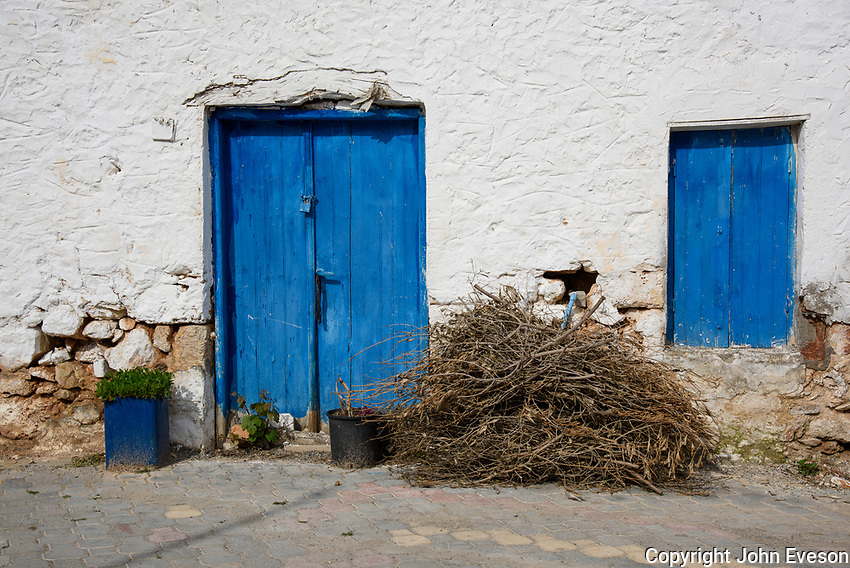 A bundle of sticks outside a traditional house in the Greek village of Analipsi, Crete, Greece.