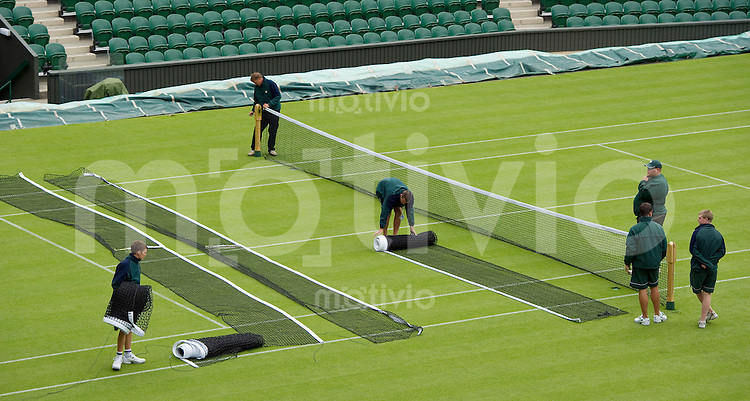 Staff sets up a net on Centre Court. Preparation for The Wimbledon Championships 2010 The All England Lawn Tennis & Croquet Club  Sunday Pre Championships Sunday 20/06/2010