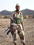 Abdel Kader, 33 years old, is a para commando officer. He risked his life to desert the Nigerien Armed Forces in 2000 and joined the NMJ in March 2008, after several years of exile in Nigeria. Northern Niger. March 2008.