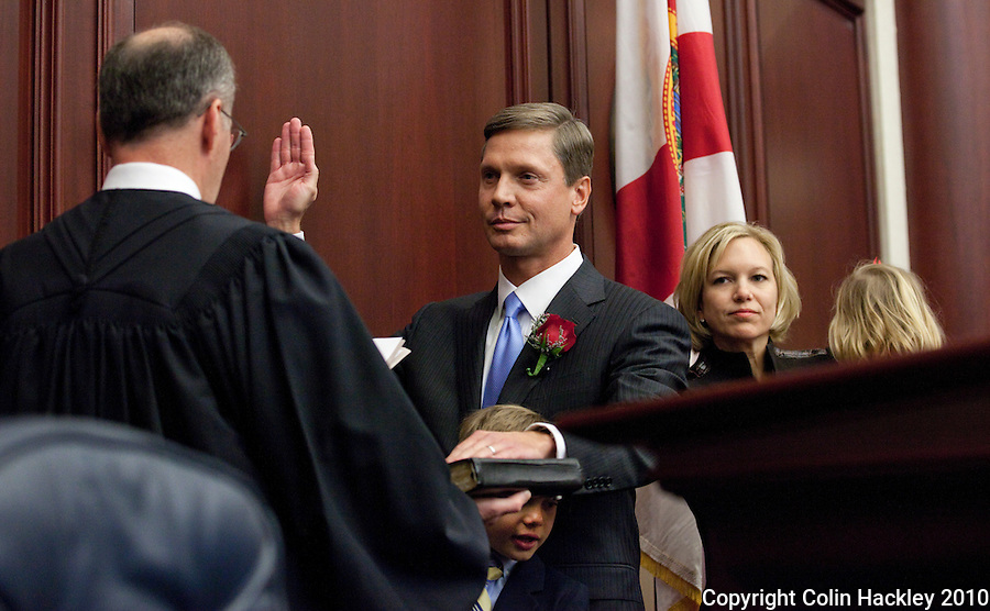 TALLAHASSEE, FLA. 11/16/10-ORG.SESS111610HACKLEY16-House Speaker Dean Cannon, R-Winter Park, takes the oath of office from Florida Supreme Court Chief Justice Charles Canaday, as his son Dean Cannon III stands in front of him and his wife Ellen  behind him during Organizational Session of the Legislature Tuesday at the Capitol in Tallahassee...COLIN HACKLEY PHOTO