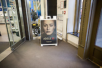 """A sign in a Best Buy in New York on Sunday, November 29, 2015 promotes Adele's new album, """"25"""". The album, released on November 20, and not available for streaming, has sold a record-breaking 3.38 million copies in its first week. (© Richard B. Levine"""