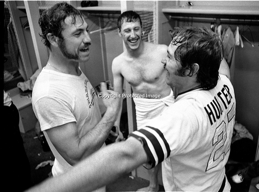"ATHLETICS CELEBRATE: Mike Epstein, Ken Holtzman and Jim ""Catfish"" Hunter celebrate in the Cincinnati dressing room after beating the Reds in the 7th game of the 1972 World Series. (photo by Ron Riesterer)"