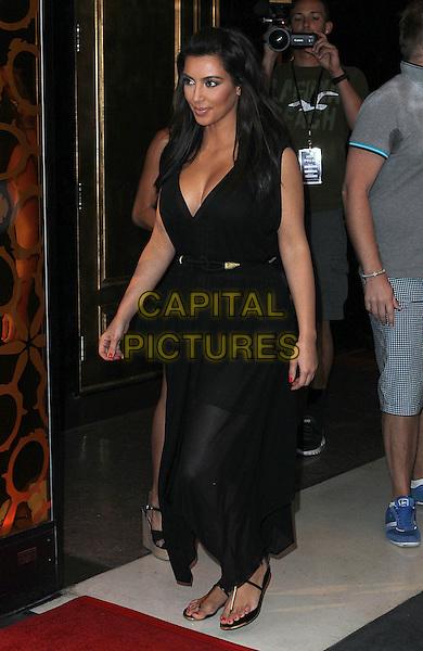 Kim Kardashian.hosts Rehab Sunday at Paradise Beach at the Hard Rock Hotel and Casino, Las Vegas, Nevada, USA..3rd June 2012 .full length black dress sheer cleavage belt .CAP/ADM/MJT.© MJT/AdMedia/Capital Pictures.
