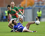 John Galvin of  Cratloe in action against Ciaran Morrissey and Darragh Sexton of Kilmurry Ibrickane during their senior football final replay at Cusack park. Photograph by John Kelly.