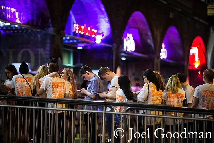 "© Joel Goodman - 07973 332324 . 16/11/2015 . Manchester , UK . Students queue to get in . Annual student pub crawl "" Carnage "" at Manchester's Deansgate Locks nightclubs venue . The event sees students visit several clubs over the course of an evening . This year's theme is "" Animal Instinct - unleash your beast "" . Photo credit : Joel Goodman"