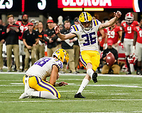 ATLANTA, GA - DECEMBER 7: Cade York #36 kicks a field goal from the hold of Clyde Townsend #28 of the LSU Tigers during a game between Georgia Bulldogs and LSU Tigers at Mercedes Benz Stadium on December 7, 2019 in Atlanta, Georgia.