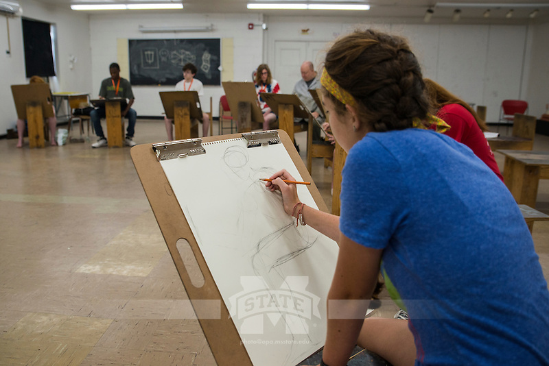 Jeff Haupt instructs Mississippi State University's INvision Visual Arts Summer Program through a drawing workshop.<br />