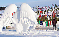 A reveller looks at a snow sculpture at the Carnaval de Quebec winter Carnival in Quebec City Wednesday February 13, 2013. The Carnaval de Quebec is one of the biggest winter festival in the World.