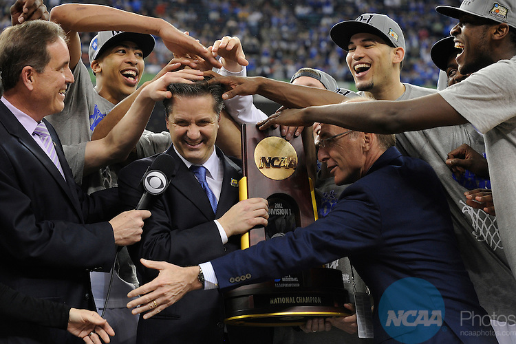 2 APR 2012: Head Coach John Calipari from the University of Kentucky gets his hair messed up by his players following the Championship Game of the 2012 NCAA Men's Division I Basketball Championship Final Four held at the Mercedes-Benz Superdome hosted by Tulane University in New Orleans, LA. Kentucky defeated Kansas 67-59 to claim the championship title. Ryan McKeee/ NCAA Photos.