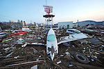 March 14, 2011, Sendai, Japan - A light plane sits on the debris after being washed away by a tsunami at Sendai Airport on Monday, March 14, 2011. The airport, located along the Pacific coast, was flooded by a 10-meter tsunami following a powerful earthquake with a magnitude of 9.0 that jolted northeastern Japanese cities on March 11, 2011. The death toll could reach 10,000 in the nation's worst and the world's fourth worst earthquake. (Photo by Natsuki Sakai/AFLO) [3615] -mis-