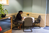 Ayanna Pressley makes notes for her speech before speaking at an event put on by Chelsea Black Community at the Chelsea Senior Center in Chelsea, Massachusetts, USA, on Wed., June 27, 2018. Pressley is running in the Democratic primary Massachusetts 7th Congressional District against incumbent Mike Capuano. Pressley is currently serving as a member of the Boston City Council, and is the first woman of color elected to the Council.