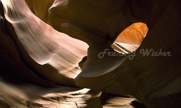 A natural sandstone window deep within the Antelope slot canyon near Page Arizona on the Navajo Tribal Park