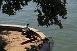 Angler fishing on the Seine River, Paris, France, Europe.