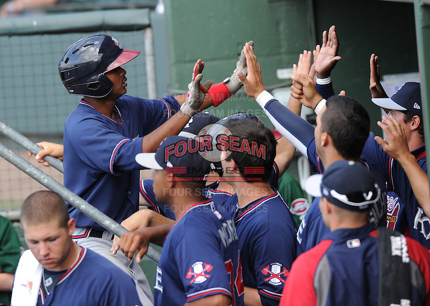 Infielder Elmer Reyes (7) of the Rome Braves is congratulated in the dugout after hitting a home run in a game against the Greenville Drive on May 6, 2012, at Fluor Field at the West End in Greenville, South Carolina. Greenville won, 11-3. (Tom Priddy/Four Seam Images)