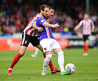 Exeter City's Ryan Harley shields the ball from Lincoln City's James Wilson<br /> <br /> Photographer Chris Vaughan/CameraSport<br /> <br /> The EFL Sky Bet League Two Play Off First Leg - Lincoln City v Exeter City - Saturday 12th May 2018 - Sincil Bank - Lincoln<br /> <br /> World Copyright &copy; 2018 CameraSport. All rights reserved. 43 Linden Ave. Countesthorpe. Leicester. England. LE8 5PG - Tel: +44 (0) 116 277 4147 - admin@camerasport.com - www.camerasport.com