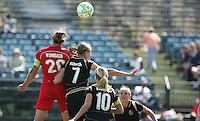 Abby Wambach (20) heads the ball over Leigh Ann Robinson (7), Leslie Osborne (10) and Rachel Buehler (right). Washington Freedom defeated FC Gold Pride 4-3 at Buck Shaw Stadium in Santa Clara, California on April 26, 2009.