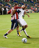 Chivas forward Justin Braun (17) battles Revolution midfielder Khano Smith (18) for the ball during the second half of the game between Chivas USA and the New England Revolution at the Home Depot Center in Carson, CA, on September 10, 2010. Chivas USA 2, New England Revolution 0.