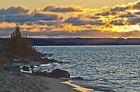 The sun sets across Sand Bay in Pictured Rocks National Lakeshore, Alger County, Michigan