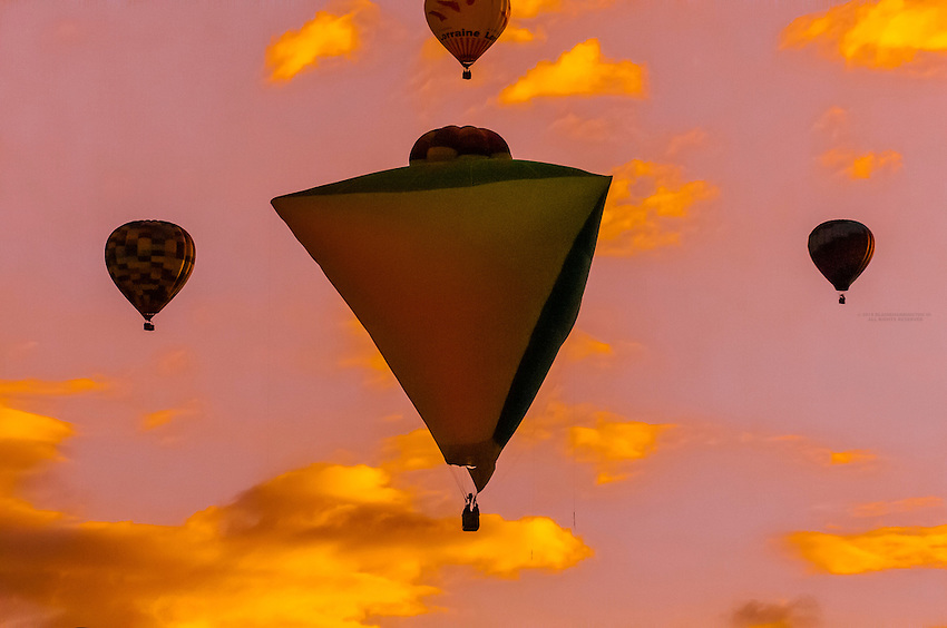 Special shapes balloon flying at sunrise, Albuquerque International Balloon Fiesta, Albuquerque, New Mexico USA.
