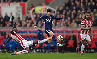 Bruno Martins Indi of Stoke tries to intercept Heung-Min Son of Tottenham during the EPL - Premier League match between Chelsea and West Ham United at Stamford Bridge, London, England on 8 April 2018. Photo by PRiME Media Images.