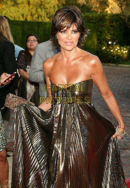 LISA RINNA.11th Annual DesignCare event benefiting the HollyRod Foundation held at a Private Residence, Beverly Hills, CA, USA..July 25th, 2009.half length pleated pleats strapless gold lame dress shiny clutch bag metallic leopard print cleavage .CAP/ADM/TL.©Tony Lowe/AdMedia/Capital Pictures.