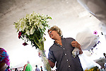Judy Beck picks out some flowers at the Sunday Certified Farmers' Market in Sacramento, California.